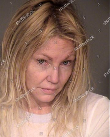 This undated booking photo provided by the Ventura County Sheriff's Office shows actress Heather Locklear. Locklear was arrested for investigation of domestic violence and fighting with sheriff's deputies at her California home, authorities said