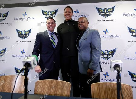 Fred Williams, Greg Bibb, Liz Cambage. Dallas Wings President and CEO Greg Bibb, left, newly acquired center Liz Cambage, center, of Australia, and head coach Fred Williams, right, pose for photos after a news conference at College Park Center where Cambage was introduced, in Arlington, Texas