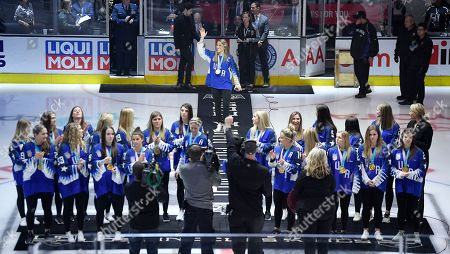Members of the women's USA Hockey gold medal team, including team captain Meghan Duggan, top, stand on the ice before dropping ceremonial puck prior to an NHL hockey game between the Los Angeles Kings and the Vegas Golden Knights, in Los Angeles