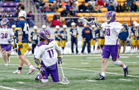 Albany, NY, U.S. - University at Albany Men's Lacrosse defeats Drexel 18-5 on Feb. 24 at Casey Stadium. Chris Ryan (#30) celebrates a goal just scored by Justin Reh (#11). (Photo by Bruce Dudek / Cal Sport Media/Eclipse Sportswire)