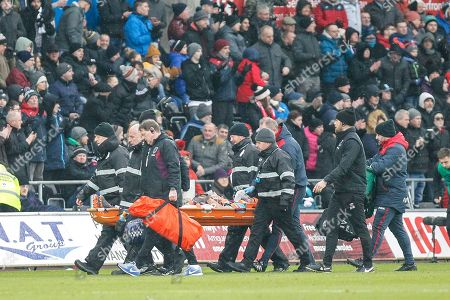 Winston Reid of West Ham United gets stretchered off