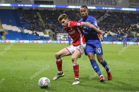 Stock Image of Joe Williams of Barnsley and Loic Damour of Cardiff City