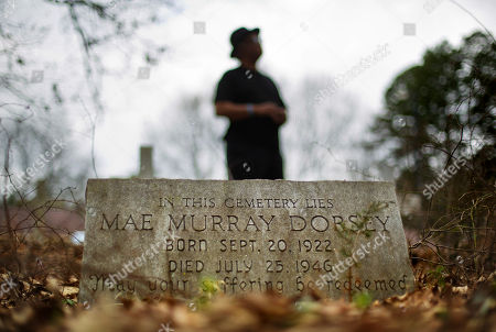 "Tyrone Brooks, a veteran civil rights activist, stands behind the tombstone of Mae Murray Dorsey who was killed in a 1946 lynching by a white mob in Monroe, Ga., . Even if no one is ultimately prosecuted for the deaths of Roger and Dorothy Malcom and George and Mae Murray Dorsey, it's important to know what happened and who was involved, said Brooks. Nonetheless, he said the closure of the investigations won't stop him. ""Our resolve is as strong as it's ever been,"" Brooks said"