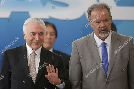 Michel Temer, Raul Jungmann. Brazil's President Michel Temer, left, and Brazil's Defense Minister Raul Jungmann attend a ceremony at the Planalto Presidential Palace to inaugurate the newly created public security ministry as part of Temer's efforts to combat high crime rates, in Brasilia, Brazil, . Jungmann will head the new ministry, and a general will be interim minister of defense