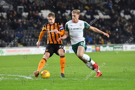 Hull City defender Michael Dawson (21) and Barnsley FC midfielder Brad Potts (20)  during the EFL Sky Bet Championship match between Hull City and Barnsley at the KCOM Stadium, Kingston upon Hull. Picture by Ian Lyall