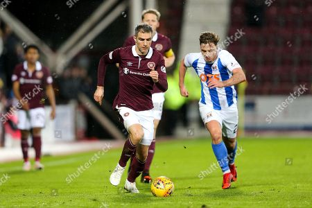 Aaron Hughes (#5) of Heart of Midlothian on the ball pursued by Eamonn Brophy (#25) of Kilmarnock during the Ladbrokes Scottish Premiership match between Heart of Midlothian and Kilmarnock at Tynecastle Stadium, Gorgie. Picture by Craig Doyle