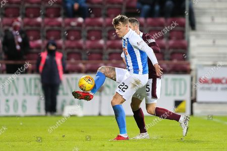 Lee Erwin (#22) of Kilmarnock controls a long pass under pressure from Aaron Hughes (#5) of Heart of Midlothian during the Ladbrokes Scottish Premiership match between Heart of Midlothian and Kilmarnock at Tynecastle Stadium, Gorgie. Picture by Craig Doyle