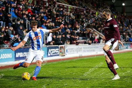 Eamonn Brophy (#25) of Kilmarnock crosses the ball into the penalty area beyond the attempted block of Aaron Hughes (#5) of Heart of Midlothian during the Ladbrokes Scottish Premiership match between Heart of Midlothian and Kilmarnock at Tynecastle Stadium, Gorgie. Picture by Craig Doyle