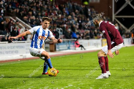 Eamonn Brophy (#25) of Kilmarnock looks to take on Aaron Hughes (#5) of Heart of Midlothian during the Ladbrokes Scottish Premiership match between Heart of Midlothian and Kilmarnock at Tynecastle Stadium, Gorgie. Picture by Craig Doyle