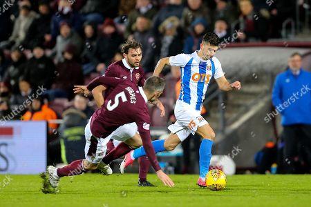 Jordan Jones (#11) of Kilmarnock takes advantage as Aaron Hughes (#5) of Heart of Midlothian slips during the Ladbrokes Scottish Premiership match between Heart of Midlothian and Kilmarnock at Tynecastle Stadium, Gorgie. Picture by Craig Doyle