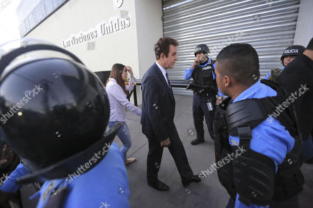 Former presidential candidate of the Alliance of Opposition Salvador Nasralla (C) enters the building of the United Nations during a protest by supporters of the Alliance of Opposition against the Dictatorship in Tegucigalpa, Honduras, 27 February 2018. The Police of Honduras used tear gas to dissolve a demonstration by supporters of the Alliance of Opposition against the Dictatorship in front of the headquarters of the United Nations in Tegucigalpa. The demonstration, which was led by the former presidential candidate of the Alliance of Opposition Salvador Nasralla and its general coordinator Manuel Zelaya, was held to protest the re-election of Honduran President Juan Orlando Hernandez in the general elections on 26 November 2017.
