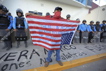 Supporters of the Alliance of Opposition against the Dictatorship protest in front of the United Nations headquarters in Tegucigalpa, Honduras, 27 February 2018. The Police of Honduras used tear gas to dissolve a demonstration by supporters of the Alliance of Opposition against the Dictatorship in front of the headquarters of the United Nations in Tegucigalpa. The demonstration, which was led by the former presidential candidate of the Alliance of Opposition Salvador Nasralla and its general coordinator Manuel Zelaya, was held to protest the re-election of Honduran President Juan Orlando Hernandez in the general elections on 26 November 2017.