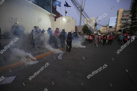 Honduran Police operate during a protest by supporters of the Alliance of Opposition against the Dictatorship in front of the United Nations headquarters in Tegucigalpa, Honduras, 27 February 2018. The Police of Honduras used tear gas to dissolve a demonstration by supporters of the Alliance of Opposition against the Dictatorship in front of the headquarters of the United Nations in Tegucigalpa. The demonstration, which was led by the former presidential candidate of the Alliance of Opposition Salvador Nasralla and its general coordinator Manuel Zelaya, was held to protest the re-election of Honduran President Juan Orlando Hernandez in the general elections on 26 November 2017.