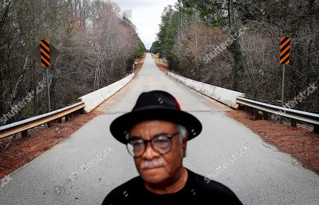 "The rural Moore's Ford Road stretches into the distance as Tyrone Brooks, a veteran civil rights activist, stands near the spot where in 1946 two young black couples were stopped by a white mob and shot multiple times in Monroe, Ga., . Even if no one is ultimately prosecuted for the deaths of Roger and Dorothy Malcom and George and Mae Murray Dorsey, it's important to know what happened and who was involved, said Brooks. Nonetheless, he said the closure of the investigations won't stop him. ""Our resolve is as strong as it's ever been,"" Brooks said"