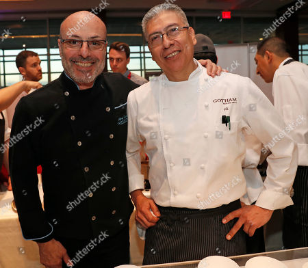Stock Photo of Alfred Portale, Jacinto Guadarrama. Gotham Bar and Grill's chefs Alfred Portale, left, and Jacinto Guadarrama pose for a photograph, during the annual benefit for C-CAP (Careers in Culinary Arts Program) in New York. Portale, an American chef, author and restaurateur, is known as the founder of the New American cuisine movement