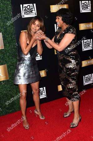 Cheryl Boone Isaacs, Halle Berry. Halle Berry and Cheryl Boone Isaacs arrive at the sixth annual ICON MANN Pre-Oscar Dinner, in Beverly Hills, Calif