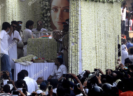 Bollywood actor and step-son Arjun Kapoor (L) and husband Boney Kapoor (R) stands near the mortal of late Indian actress Sridevi Kapoor during her funeral procession in Mumbai, India, 28 February 2018. According to media reports, Indian actress Sridevi Kapoor died at the age of 54 while attending a family wedding in Dubai, United Arab Emirates.