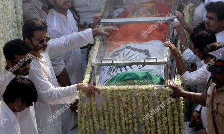 Anil Kapoor, Arjun Kapoor. Actors Anil Kapoor, third left and Arjun Kapoor, second left, stand beside as the body of Indian actress Sridevi covered with the Indian flag is carried in truck during her funeral in Mumbai, India, . Lining up for hours and visibly grief-stricken, thousands of mourning fans paid their respects Wednesday to Sridevi, the iconic Bollywood actress who drowned accidentally in a Dubai hotel bathtub over the weekend