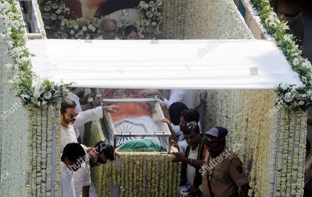 Boney Kapoor, Anil Kapoor, Arjun Kapoor. Husband Boney Kapoor, top, actors Anil Kapoor, third left and Arjun Kapoor, second left, stand beside as the body of Indian actress Sridevi covered with the Indian flag is carried in truck during her funeral in Mumbai, India, . Lining up for hours and visibly grief-stricken, thousands of mourning fans paid their respects Wednesday to Sridevi, the iconic Bollywood actress who drowned accidentally in a Dubai hotel bathtub over the weekend