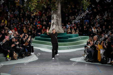 Portuguese fashion designer Felipe Oliveira Baptista acknowledges applause after the presentation of Lacoste's ready-to-wear fall/winter 2018/2019 fashion collection in Paris