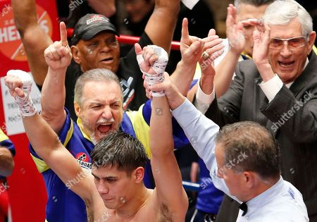 Champion Daniel Roman of the U.S., bottom left, is congratulated after defeating Japanese challenger Ryo Matsumoto in their WBA super bantamweight world boxing title match in Tokyo, . Roman defended his title by a unanimous decision