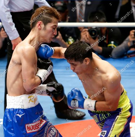 Daniel Roman, Ryo Matsumoto. Champion Daniel Roman, right, of the U.S. sends a right to Japanese challenger Ryo Matsumoto exchange their punches in the first round of their WBA super bantamweight world boxing title match in Tokyo, . Roman defended his title by a unanimous decision