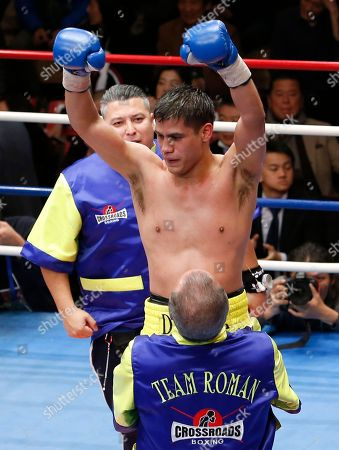 Champion Daniel Roman of the U.S. is celebrated by his corner's man after defeating Japanese challenger Ryo Matsumoto in their WBA super bantamweight world boxing title match in Tokyo, . Roman defended his title by a unanimous decision