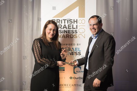 Stock Picture of Joanne Winston, MD of JP Morgan, presenting the Lifetime Achievement Award to Zvi Noe on behalf of his father, entrepreneur Leo Noe.