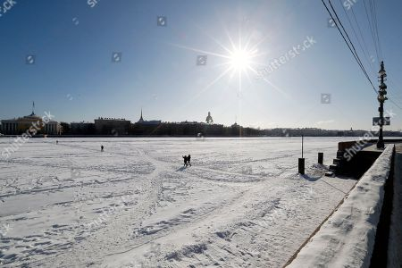 Seasonal weather st petersburg stock photos exclusive shutterstock people pass the frozen neva river in central st petersburg russia publicscrutiny Gallery