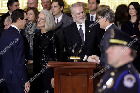 Stock Photo of Treasury Secretary Stephen Mnuchin (L) visits with Rev. Billy Graham's daughter Anne Graham Lotz and his son Ned Graham talks with Energy Secretary Rick Perry following a ceremony to honor Rev. Graham as his body lies in honor in the Rotunda of the US Capitol in Washington, DC, USA, 28 February 2018. Graham was the nation's best know Christian evangelist, preaching to millions worldwide, as well as being an advisor to US presidents over his 6 decade career.
