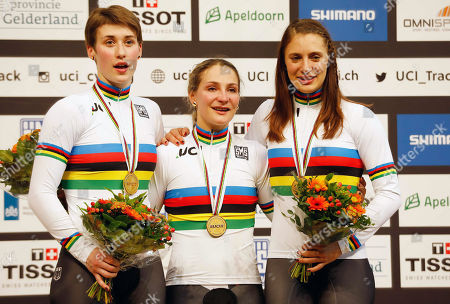 Kristina Vogel (C), Sophie Grabosch (L) and Miriam Welte of Germany celebrate on the podium after winning the women's Team Sprint at the UCI Track Cycling World Championships in Apeldoorn, The Netherlands, 28 February 2018.