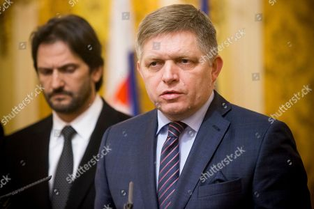 Slovak Prime Minister Robert Fico, right, gives a media statement, with Minister of Interior Robert Kalinak, left, after a silent protest march in memory of murdered journalist Jan Kuciak and his girlfriend Martina Kusnirova in Bratislava, Slovakia on . Investigative journalist Kuciak was shot dead in Slovakia last week while working on a story about the activities of Italian mafia in Slovakia and their alleged links to people close to Prime Minister Robert Fico