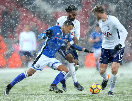 Joe Thompson of Rochdale takes on Danny Rose of Tottenham Hotspur and Eric Dier of Tottenham Hotspur