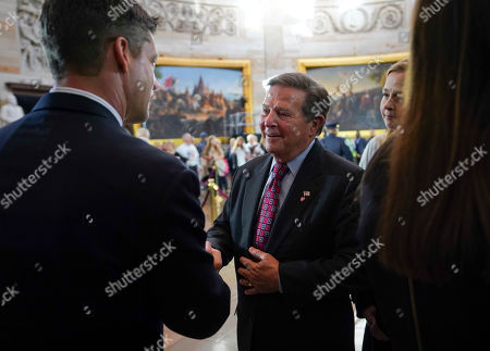 Stock Picture of Tom DeLay, Steve Wright. Former House majority leader Tom DeLay, R-Texas, center, stops to greet Steve Wright, left, great grandson of Reverend Billy Graham, and other members of the Graham family as the casket of Rev. Graham lies in honor at the Rotunda of the U.S. Capitol Building in Washington