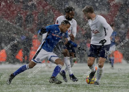 Rochdale's Joe Thompson, falls under pressure from Tottenham Hotspur's Mousa Dembele and Tottenham Hotspur's Eric Dier, right, during the English FA Cup fifth round replay soccer match between Tottenham Hotspur and Rochdale at Wembley stadium in London