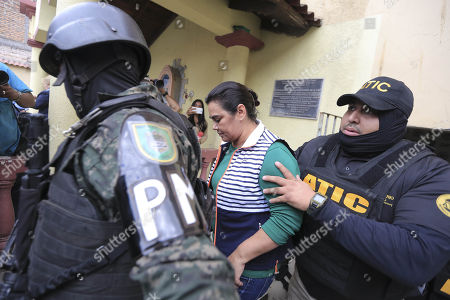 Honduran Military and law enforcement officers of the Technical Agency for Criminal Investigation (ATIC) escort former Honduran First Lady Rosa Elena Bonilla (C), wife of former Honduran President Porfirio Lobo (2010-2014), in Tegucigalpa, Honduras, 28 February 2018. Bonilla was arrested for alleged corruption.