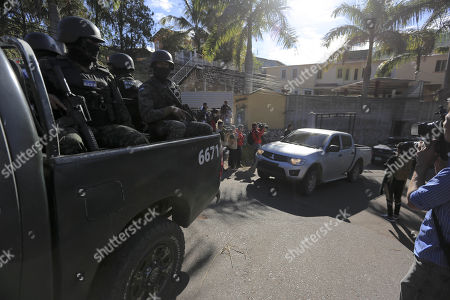 Honduran military escorts the car transporting  the former Honduran First Lady Rosa Elena Bonilla (C), wife of former Honduran President Porfirio Lobo (2010-2014), Tegucigalpa, Honduras, 28 February 2018. Bonilla was arrested for alleged corruption.