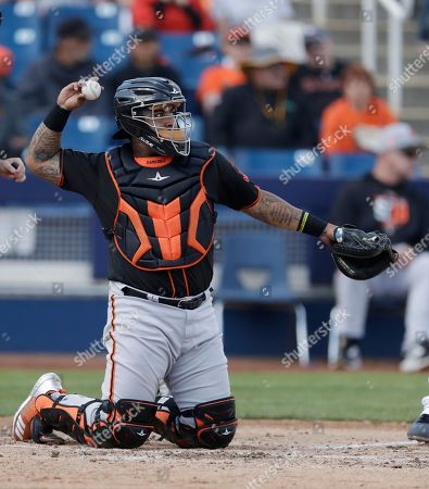 San Francisco Giants catcher Hector Sanchez throws during the first inning of a spring training baseball game against the Milwaukee Brewers, in Maryvale, Ariz