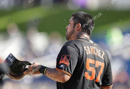 San Francisco Giants' Hector Sanchez stands on third during the fifth inning of a spring training baseball game against the Milwaukee Brewers, in Maryvale, Ariz
