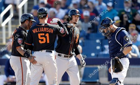 Mac Williamson, Hecktor Sanchez, Jerrett Parker. San Francisco Giants' Mac Williamson (51) is greeted at home by Hector Sanchez, left, and Jarrett Parker after they scored on Williamson's three-run home run during the fifth inning of a spring training baseball game against the Milwaukee Brewers, in Maryvale, Ariz