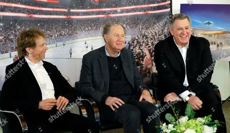 Hollywood producer Jerry Bruckheimer, billionaire David Bonderman, and Oak View Group Chief Executive Tim Leiweke take part in a TV interview, in Seattle. The group trying to bring NHL hockey to Seattle says it hopes to hear in June whether its application for an expansion team succeeds, and is launching a season-ticket deposit drive Thursday meant to prove fan interest in a hockey franchise