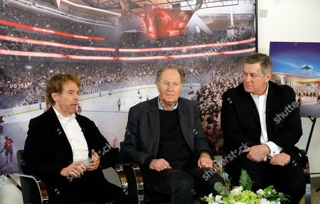 Hollywood producer Jerry Bruckheimer, billionaire David Bonderman, and Oak View Group Chief Executive Tim Leiweke, from left, take part in a TV interview, in Seattle. The group trying to bring NHL hockey to Seattle says it hopes to hear in June whether its application for an expansion team succeeds, and is launching a season-ticket deposit drive Thursday meant to prove fan interest in a hockey franchise