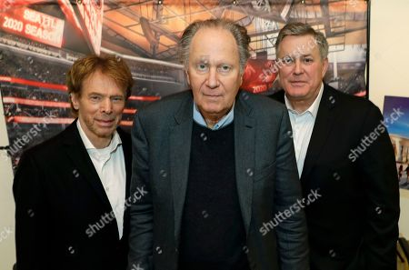 From left, Hollywood producer Jerry Bruckheimer, billionaire David Bonderman, and Oak View Group Chief Executive Tim Leiweke pose for a photo before an AP interview, in Seattle. The group trying to bring NHL hockey to Seattle say they hope to hear in June whether their application for an expansion team succeeds, and they are launching a season-ticket deposit drive on Thursday meant to proove fan interest in a hockey franchise