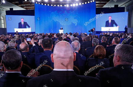 Russian lawmaker and former boxer Nikolai Valuev (front C, back to camera) listens among others as Russian President Vladimir Putin addresses the Federal Assembly at the Manezh Central Exhibition Hall in Moscow, Russia, 01 March 2018.