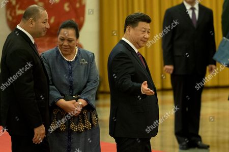 Tupou VI, Xi Jinping. King Tupou VI of Tonga, at left is shown the way by Chinese President Xi Jinping, center during a welcome ceremony held at the Great Hall of the People in Beijing