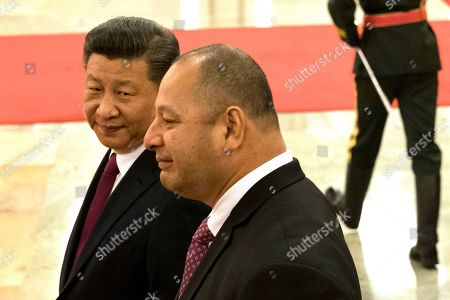 Xi Jinping, Tupou VI. Chinese President Xi Jinping, left looks over at King Tupou VI of Tonga during a welcome ceremony held at the Great Hall of the People in Beijing