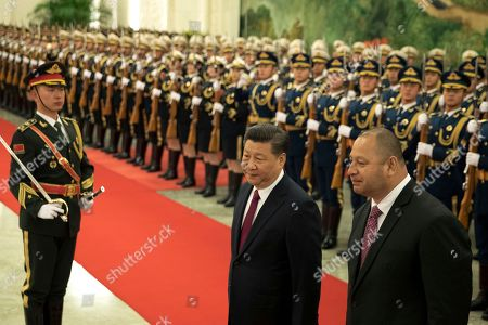 Xi Jinping, Tupou VI. King Tupou VI of Tonga, at right walks with Chinese President Xi Jinping, center during a welcome ceremony held at the Great Hall of the People in Beijing