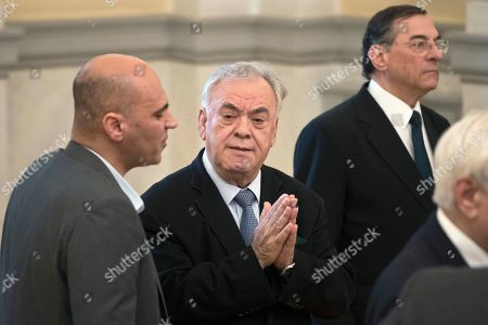 Yannis Dragasakis, Konstantinos Stratis. The new Economy and Development Minister Yannis Dragasakis, second left, talks with Deputy Culture Minister Konstantinos Stratis during a swearing-in ceremony of newly appointed members of the government, at the Greek Presidential Palace, . Prime Minister Alexis Tsipras has appointed deputy premier Yannis Dragasakis as the country's economy and development minister in a limited cabinet reshuffle triggered by a rent allowance scandal