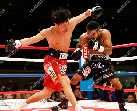Stock Picture of Shinsuke Yamanaka, Luis Nery. Japan's Shinsuke Yamanaka, left, falls down after getting a punch from Mexico's Luis Nery in the first round of their rematch for the WBC bantamweight world boxing title in Tokyo . Nery knocked out Yamanaka in the second round to clinch the title