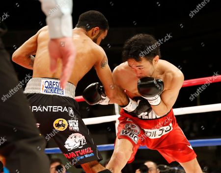 Shinsuke Yamanaka, Luis Nery. Japan's Shinsuke Yamanaka, right, gets a right from Mexico's Luis Nery in the first round of their rematch for the WBC bantamweight world boxing title in Tokyo . Nery knocked out Yamanaka in the second round to clinch the title